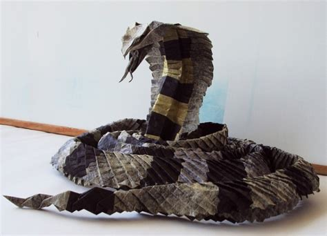 Origami Cobra - creative visual a king cobra folded from a single