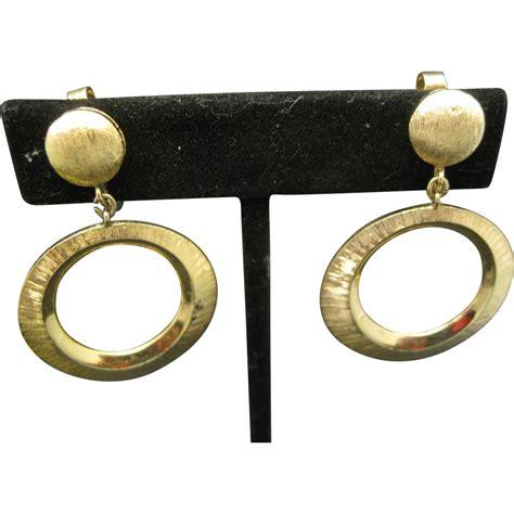 Gold Tone Clip Earrings trifari hoop earrings clip on gold tone metal from