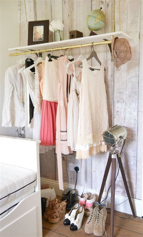 Wardrobe Clothes Hanging Rail by Hanging Clothes Rail Fauxwoodwallpaper Vintageglobe