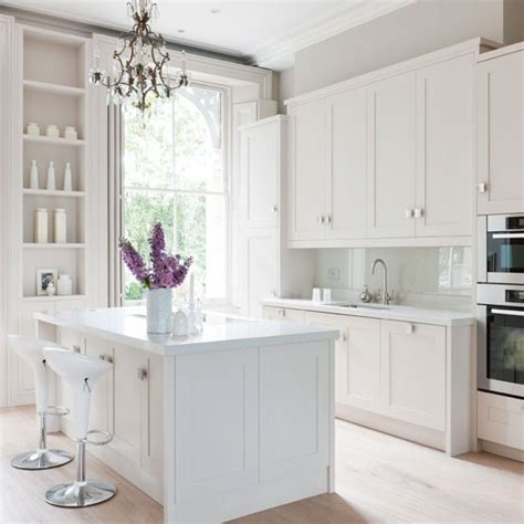 kitchen small countertops white painted white kitchen with white cabinetry island unit and alcove shelving