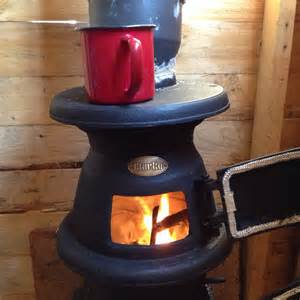 a wood burner and a shed spade fork spoon