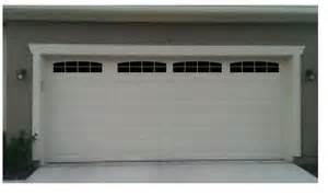 Carriage house style faux double garage door windows with wide panel