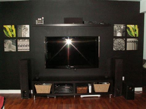 painting a black feature wall camouflage your tv with black paint inspired interiors