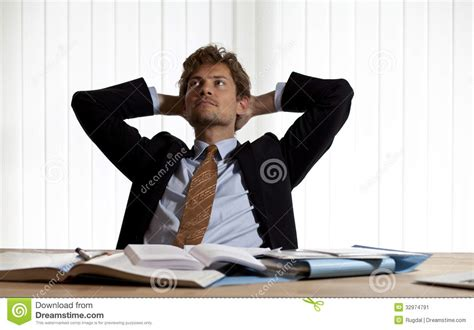 Leaning Back In Chair by Wondering Businessman Leaning Back In His Chair Stock