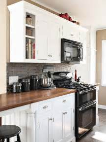 Delightful Ideas For A Backsplash In Kitchen #5: How-to-decorate-a-kitchen-with-black-appliances-and-white-cabinets.-Ideas-and-updates.jpg