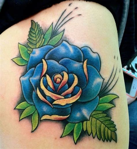 traditional blue rose tattoo on thigh bleed ink