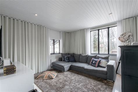 White joins the shades of gray in this Scandinavian home