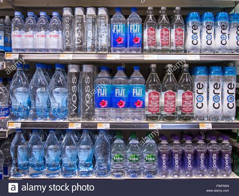 Shelf Of Water rows of name brand bottled waters on grocery store shelves