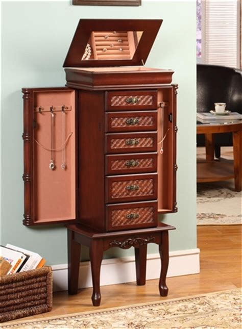 large tropical jewelry armoire with bamboo carved detail