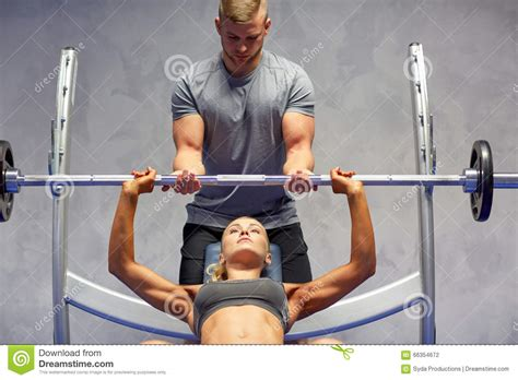 bench press man breasts man flexing muscles while bench pressing weights at a gym