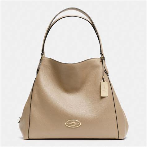 Shoulder Bag Coach coach edie shoulder bag in pebble leather in orange light gold putty lyst