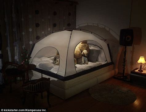 Boys Treehouse Bed - room in room claims four poster cover can help insulate you at night daily mail online