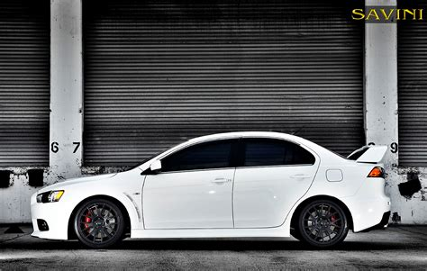 white mitsubishi lancer with black rims evo savini wheels