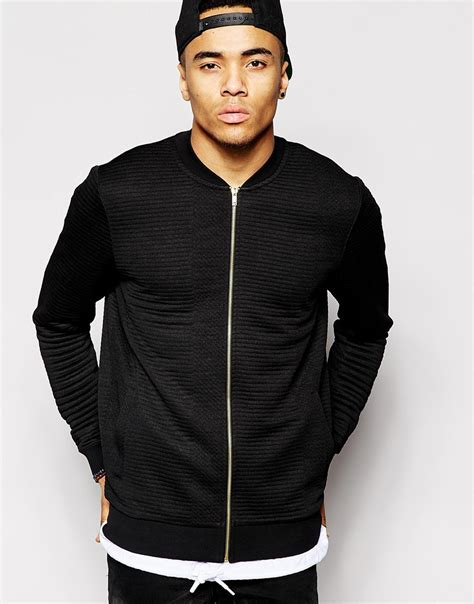 Black Quilted Bomber Jacket by Asos Quilted Bomber Jacket In Jersey With Gold Zips In
