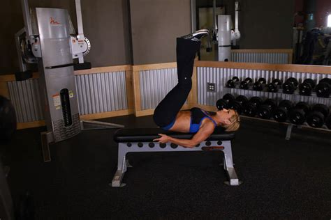 leg raise on bench flat bench lying leg raise exercise guide and video