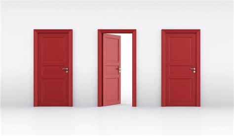 Three Doors three doors door choose a person thinking in front of