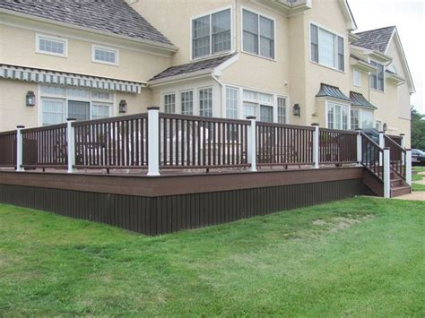 Decks On Houses by Brown Deck Yellow House Deck Railing Including Light
