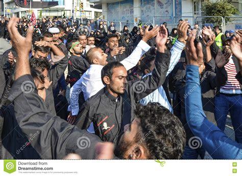 shia muslim men shout islamic slogans ashura procession