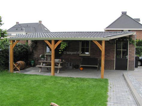 voliere kachel veranda van eiken staanders en dakpanplaten