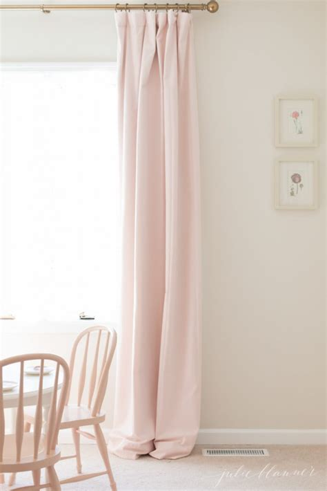 how hang curtains how to hang curtains to make them look like custom drapes