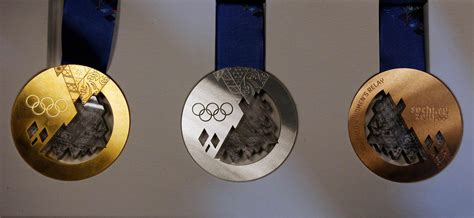 gold medal winter books olympic medal well done now pay your taxes sam