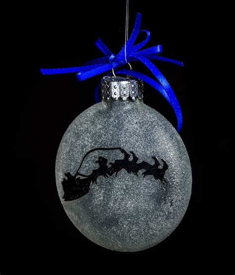 christmas ornaments by eb santa across the moon