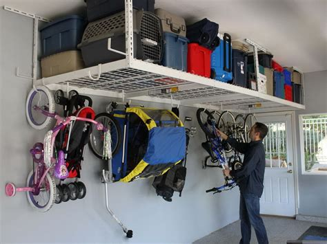 Garage Ceiling Bike Rack by Garage Bike Storage Side View Of Bicycle Hung From A