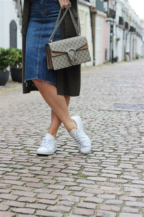 casually styling a denim midi clutch carry on