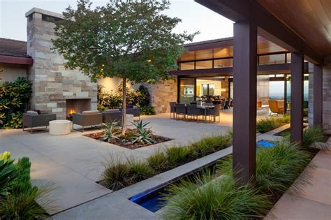 outdoor courtyard contemporary courtyard with outdoor fireplace hgtv