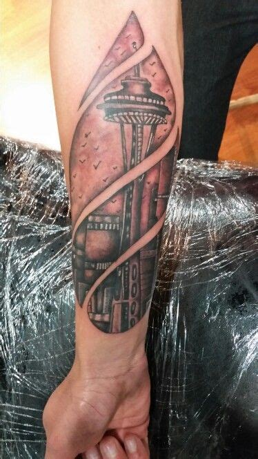 tattoo artists seattle seattle skyline space needle in a raindrop rock