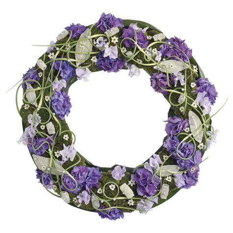 de laares bloemen es prijs rouwkrans paars wit via 123bloemenbestellen nl
