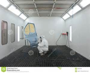 painter works in a spray booth royalty free stock photo