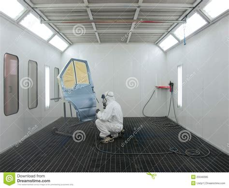 4 Car Garage Plans painter works in a spray booth royalty free stock photo