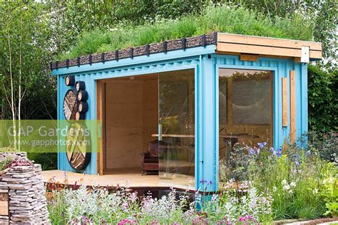 shipping container in garden gap gardens turquoise painted garden office with living