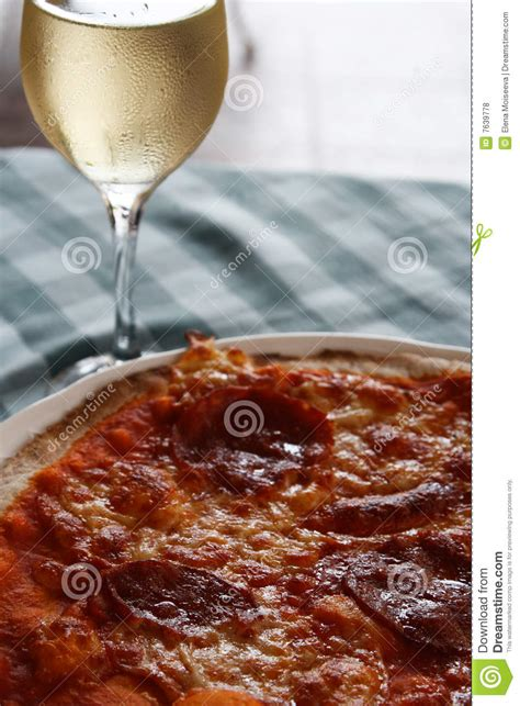 pepperoni pizza with white wine glass stock photo image 7639778