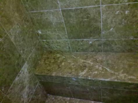 polished emperador brown sudbury marble shower walls bench