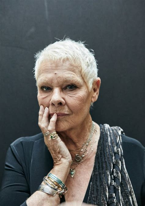 judi bench queen bow down to tattoo flashing octogenarian dame dench