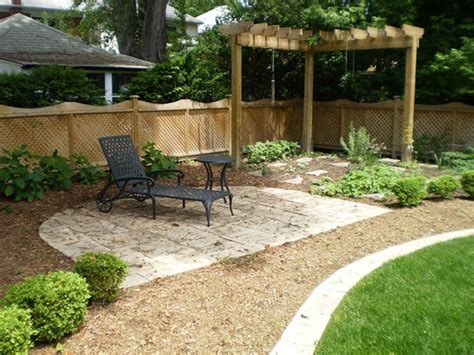 easy backyard garden ideas black chaise lounge and corner wooden pergola for simple