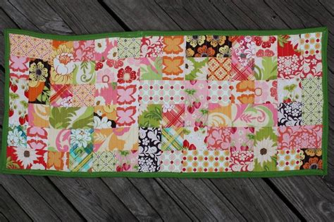 charm pack table runner free tutorial orange sherbet table runner by lawson