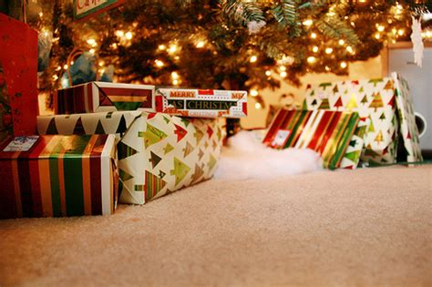 images of christmas gifts under the tree christmas gifts under the tree pictures photos and