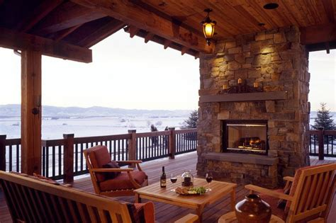 covered deck with fireplace so cozy the cox family