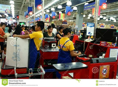 cashiers and bagger boys in a grocery store in the philippines editorial stock image image