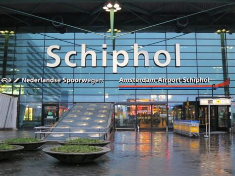 schiphol airport easiest cheapest way to get from schiphol to amsterdam