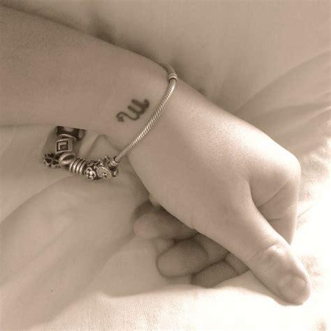 scorpio zodiac tattoo on wrist small scorpio zodiac symbol tattoo on wrist tattooshunt com