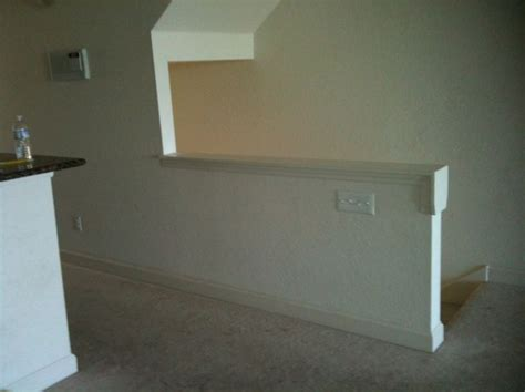 replace banister with half wall remove half walls replace with wood railing balusters