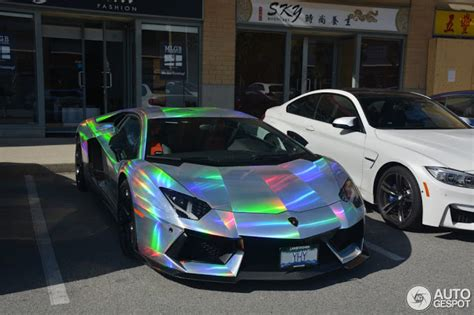 rainbow chrome ferrari lamborghini aventador spotted in mind warping holographic wrap
