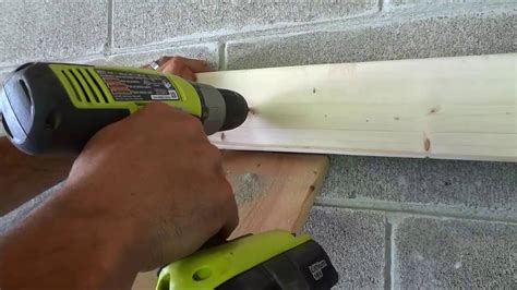 anchor into a concrete wall using tapcon concrete screws to secure wood to cinderblock