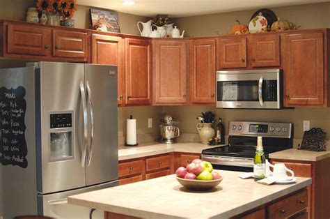 Top Kitchen Cabinets by Decorations On Top Of Kitchen Cabinets 3343 The Green