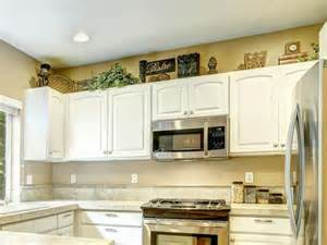 decorate above kitchen cabinets what to do with space above kitchen cabinets 775 x
