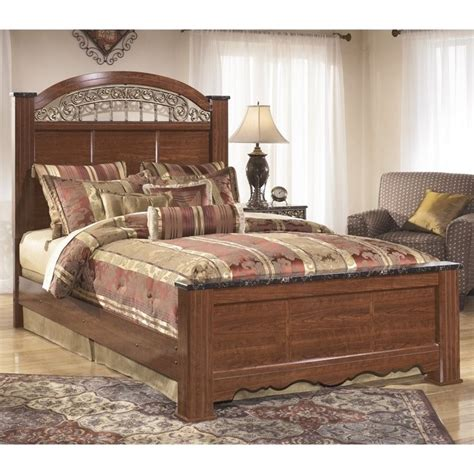 ashley poster bed ashley fairbrooks estates wood queen poster panel bed in